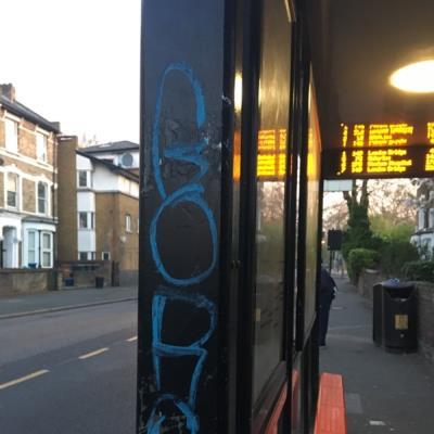 Graffiti bus stop -89A Rectory Rd, Clapton, London N16 7PP, UK