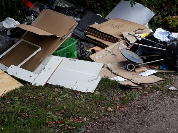 Yet more rubbish dumped on car park at bottom of Bonchurch St. including a BBQ  also a Utility Bill addressed to 143 Dunton St -231 Tudor Road, Leicester, LE3 5JH