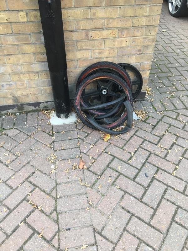 Pile of old bike wheels outside 11 West Mersea Close-10 West Mersea Close, London, E16 1UD
