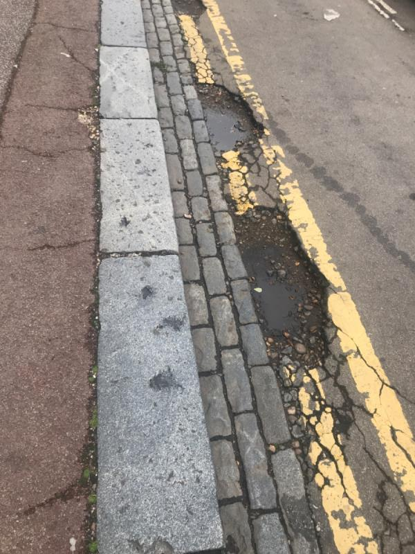 Sams pot holes that I've been reporting for years. Waterloo road at junction with Tower Hamlets -81 Tower Hamlets Road, London, E7 9DA