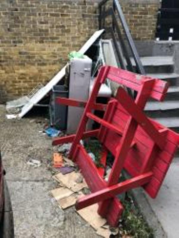 Rubbish dumped behind Sylvan Post pub including one of pub benches. Reported via Fix My Street-24-28 Dartmouth Road, London, SE23 3XU