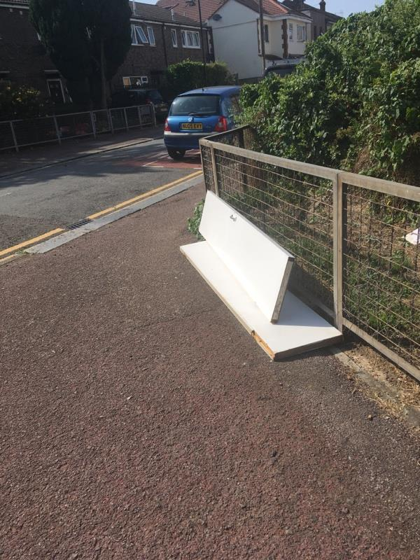 Dumped wooden doors -48 Wellington Road, London, E7 9BU