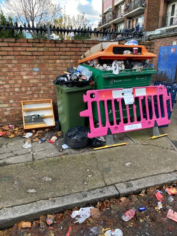 Someone repeatedly uses recycling bin area to fly tip. This is an ongoing issue. image 1-11 Bull Road, London, E15 3HQ