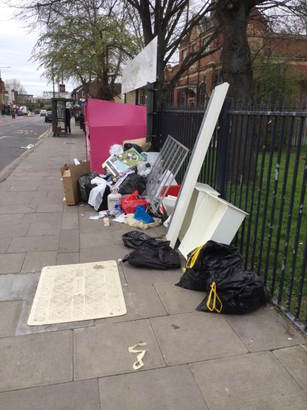 Large fly tip, gas canister amongst items-Custom House Library Prince Regent Lane, Canning Town, E16 3JJ