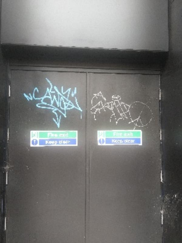 2 graffiti tags on right hand side of door way of flannels on halford street-9 Halford Street, Leicester, LE1 1JB
