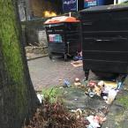 Overflowing rubbish including food waste by bus stop on dalston lane -Northbourne House Pembury Road, London, E5 8LZ