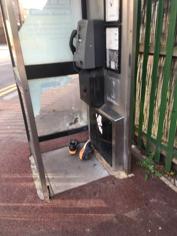 A man left his trainers behind in payphone-10a Odessa Road, London, E7 9BG
