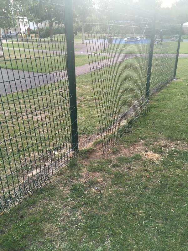 FAO Green Spaces- wire fencing has separated behind basketball hoop area. (again)Sharp edges exposed, dangerously for kiddies Location Odessa Open Space -95 Odessa Road, London, E7 9BL