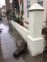 Building materials, bitumen rubble and old wooden sleepers, have been dumped alongside the recycling bags between the first two blocks  of Rowhill Mansions  image 2-152 Clarence Road, London, E5 8DY