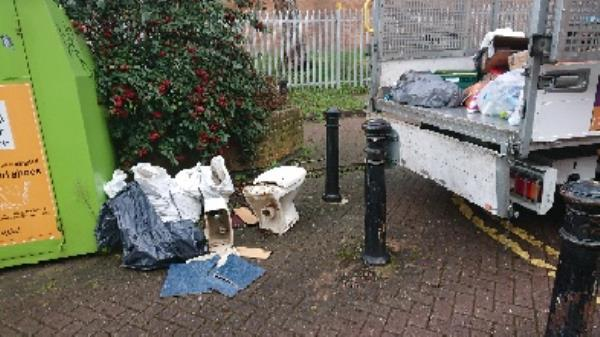Toilet cistern five heavy rubble sack. With floor tiles removed.. Flytipping. -42 Park View, Reading RG2 0BX, UK
