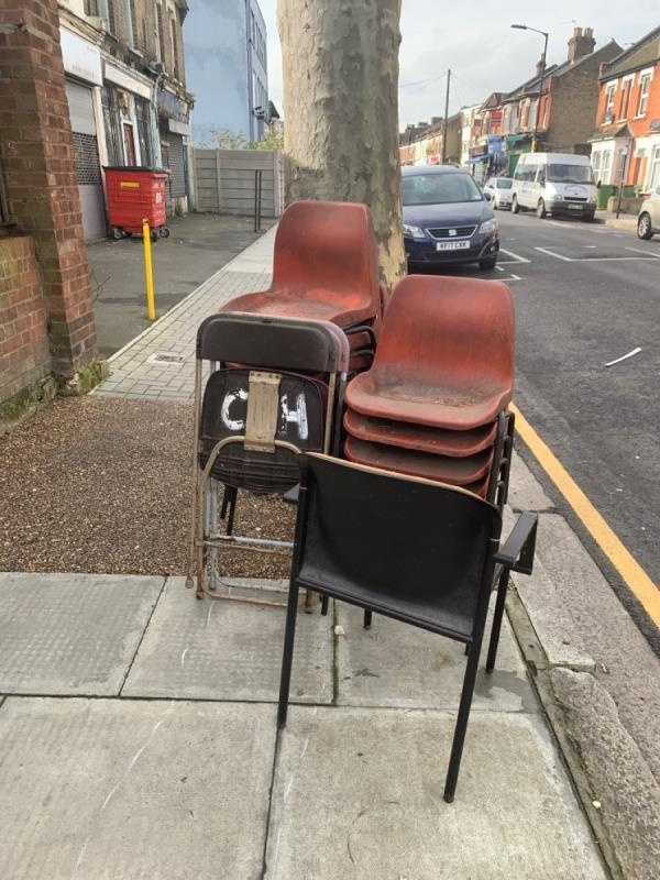 Pile of chairs left on street. -76b Church Road, London, E12 6AF