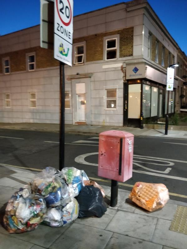 Dumped black bag on the pavement at the corner of Leytonstone and Henniker Road E15-135-137 Leytonstone Road, London, E15 1LH