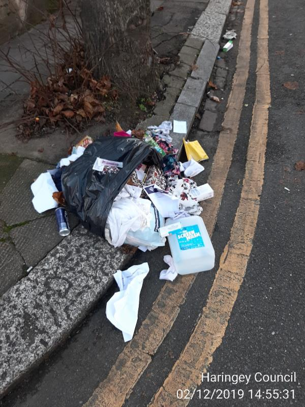 bag of household waste on newly Road junction with hartham  Road N17-64 Newlyn Road, London, N17 6RX