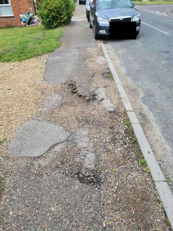The pavement is breaking up causing a hazard to pedestrians etc image 1-1 Furze Meadow, Nyewood, GU31 5JD
