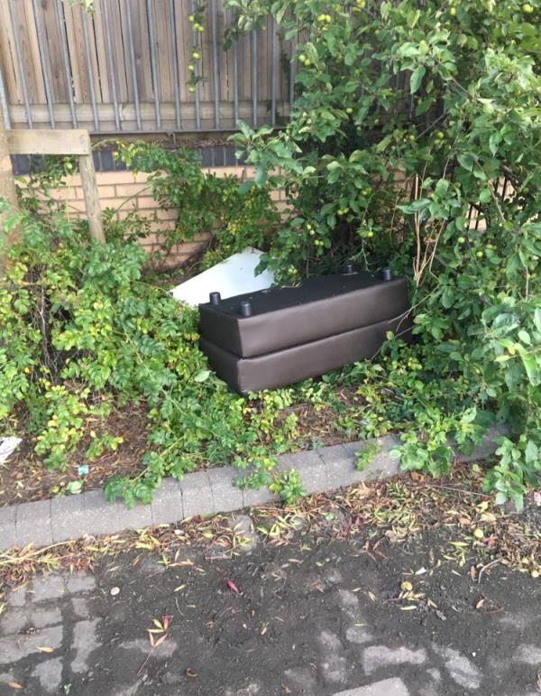 Furniture dumped in the bushes at the side of the school.  Can be found in the bushes at the end of the barriers that stop cars driving up the pedestrian walkway. -1 Ramsgate Close, London, E16 2AR