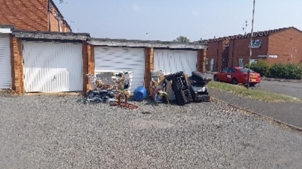 Fly tipping outside garages on  Grovebury Road, Abbey Rise  Leicester-28 Abbey Drive, Leicester, LE4 2TN