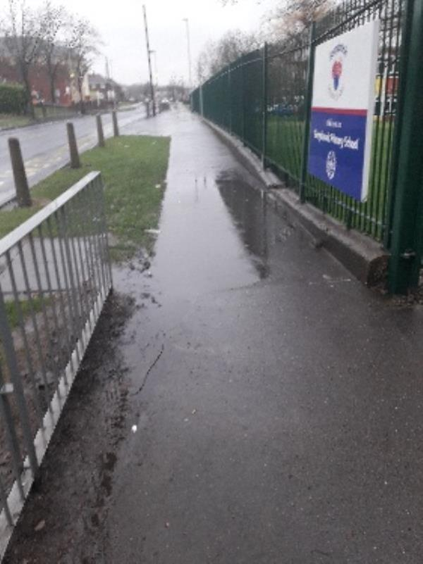 Footpath flooding outside the main access foot gate for Berrybrook Primary. Children who walk from the Zebra crossing direction are found climbing the fence and wall to get into school without getting their feet wet. In turn, some children and parents now cross the road at Westcroft Avenue putting themselves at increased danger to cross the road into school instead of using the Crossing Patrol-22 Underhill Lane, Wolverhampton, WV10 8LS