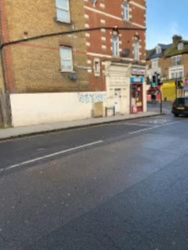Remove graffiti from side wall-106 Newlands Park, London, SE26 5NB
