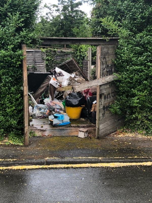 Fly tipping to the rear of a property on Darlaston lane adjacent to the entrance to hunters close.-22 Darlaston Ln, Bilston WV14 7BW, UK