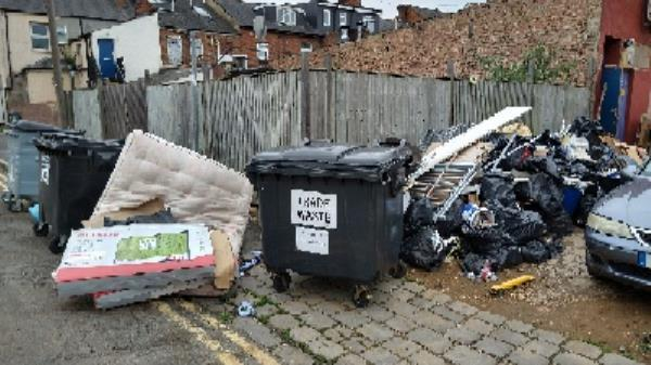 fly-tipping, bins and rubbish in alley totally blocking the pavement on amity Road-1-3 Amity Road, Reading, RG1 3LN