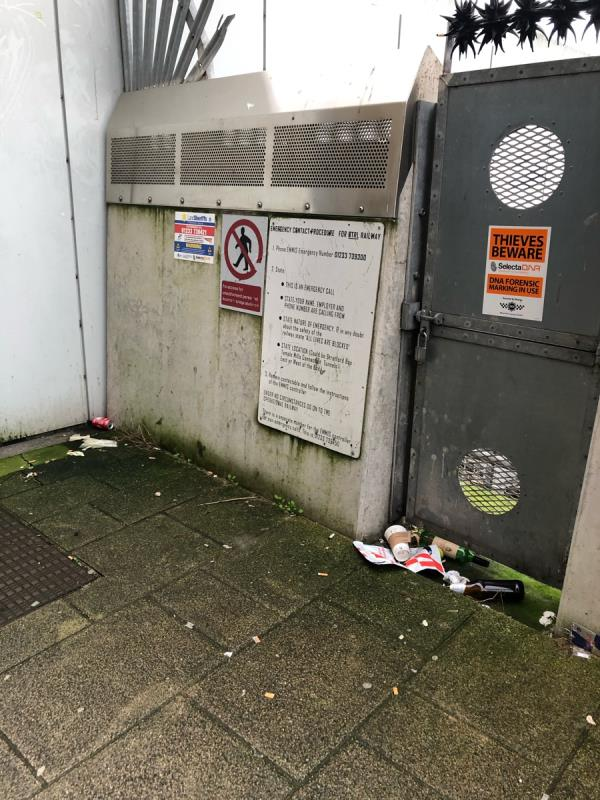 Litter including glass bottles on pavement that runs past the north service yard at Westfield -100 Montfichet Road, London, E20 1EH
