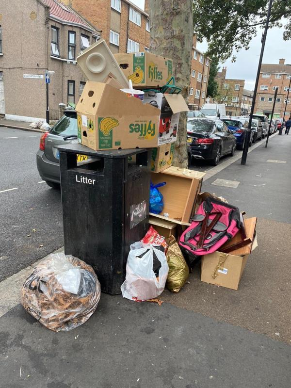 Discarded boxes and waste by the bin-6 Saint Stephen's Road, East Ham, E6 1AW