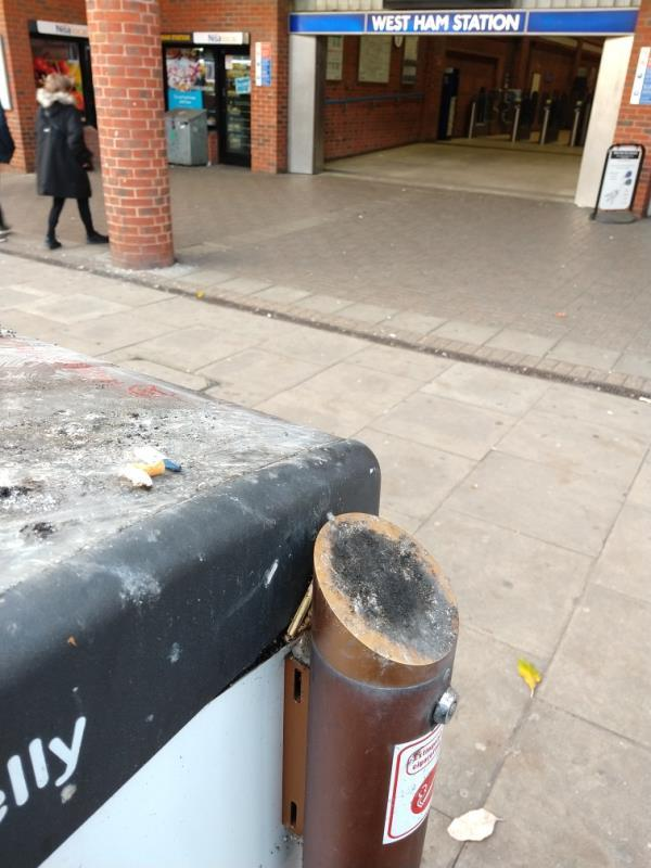 Ashtrays of the big belly bins outside West Ham station are still full. they are never emptied.-16 Memorial Avenue, London, E15 3BN
