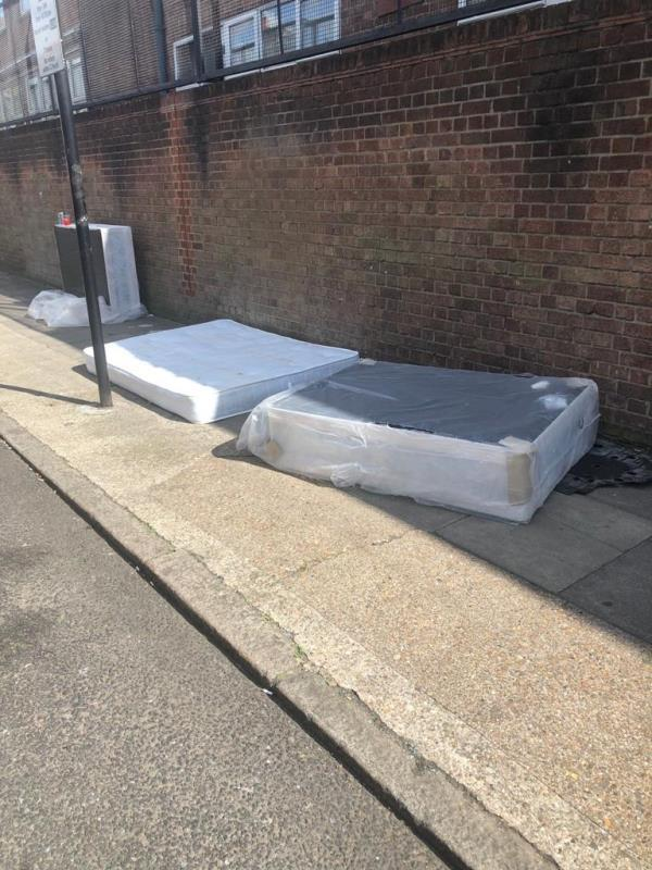 Double duvan bed base and mattress discarded at the side of the road -2e Grosvenor Road, London, E7 8JA