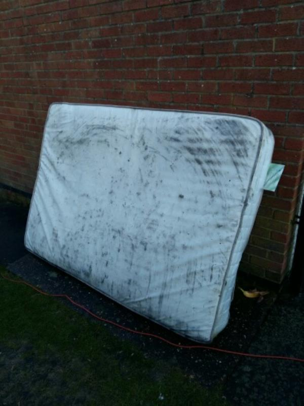 Old mattress left around back of garages and has been there for 2 months. Nobody had owned up to it-27 Foxcroft Close, Leicester, LE3 2DZ