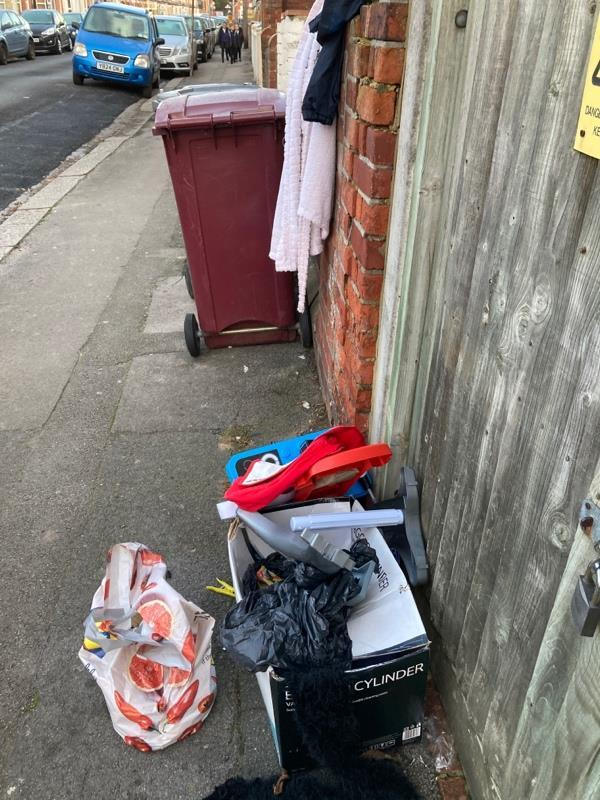 Rubbish and clothes routinely left on pavement -101a Belmont Road, Reading, RG30 2UY