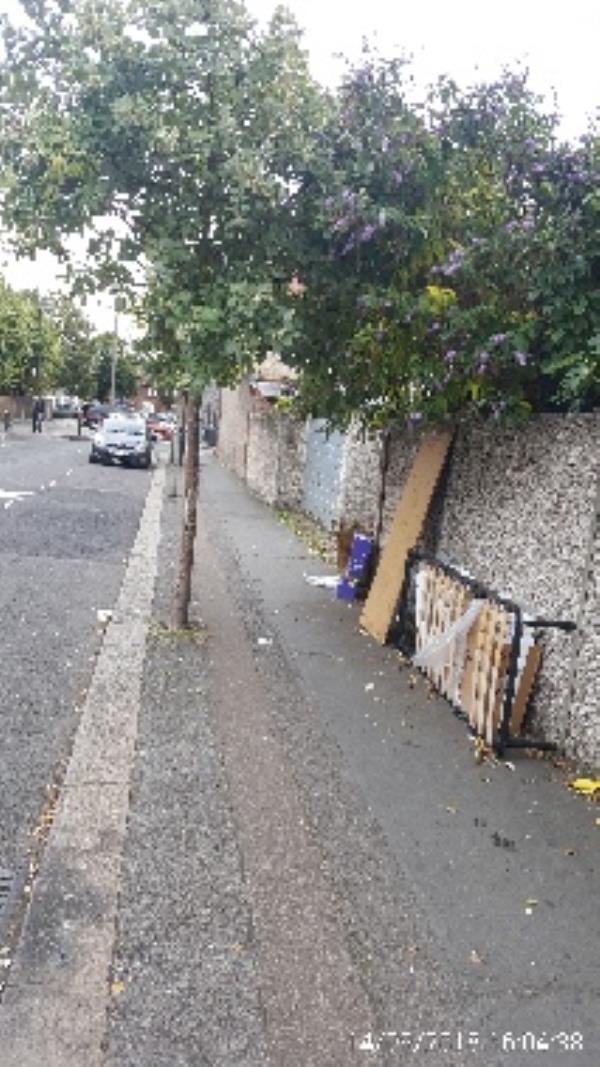 bed frame and some waste dumped opposite 163 Granville rd. also stone slabs near post-163-149 Granville Rd, London N22 5LS, UK