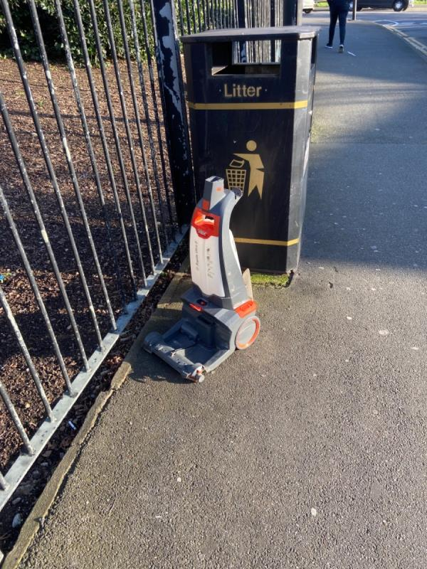 Carpet cleaning machine dumped by bin. Entrance to Beckton District Park car park-6 Goldcrest Cl, London E16 3RX, UK