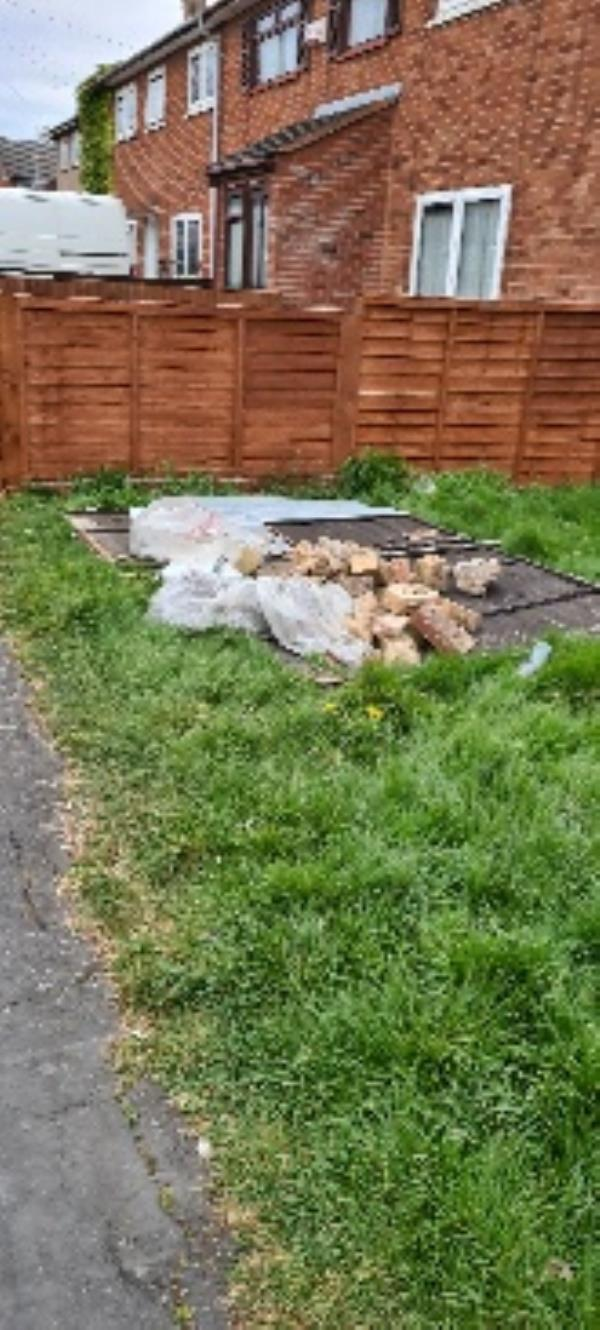 rubbish left outside including bricks that have been used to  vandalise cars-40 Swinford Avenue, Leicester, LE2 9RW