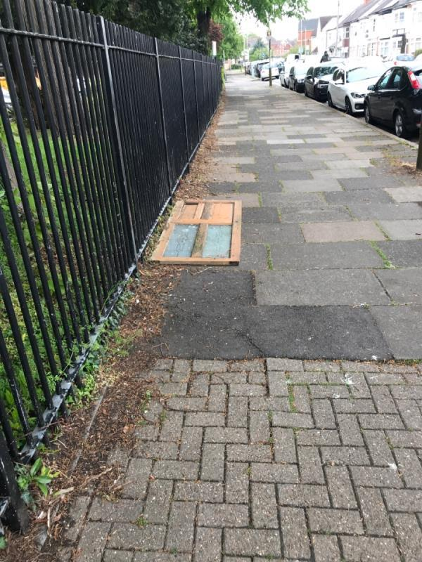 Fly tipping. Wooden door left on street-42 Evington Valley Road, Leicester, LE5 5LL
