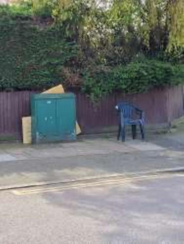 Please clear cardboard and a plastic chair from by cable boxo-50 Farmfield Road, Bromley, BR1 4NG
