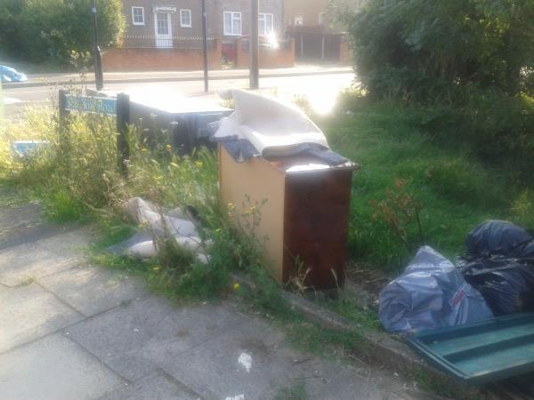 Junction of Churchdown.  Please clear flytip from grass area-54 Shroffold Road, Bromley, BR1 5PE