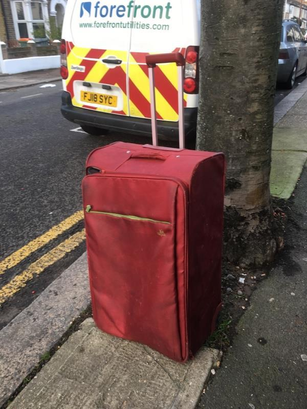 Suitcase on Tunmarsh Lane at junction with Coronation Road -108 Tunmarsh Lane, London, E13 9