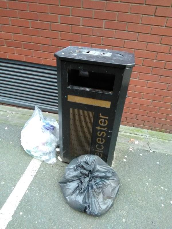 Waste left next to public litter bin outside 3 Colton Square-3 Colton Square, Colton St, Leicester LE1 1QH, UK