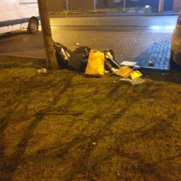 fly tipping in usual spot by playground-201-204 Staveley Road, Wolverhampton, WV6 0LZ