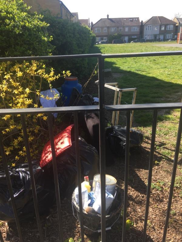 Flytip chucked over fence in Odessa open space-42 Odessa Road, London, E7 9BQ