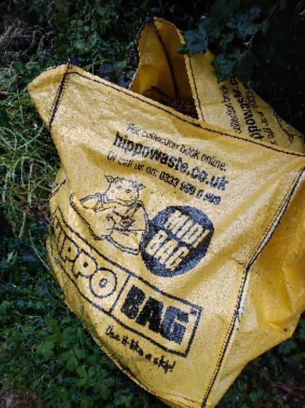 Hippo bag full of garden waste (could someone phone hippo bags  and  get them to pick it up) be here for over a Mt now-54 Galsworthy Dr, Reading RG4 6PP, UK
