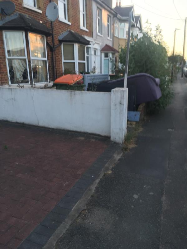 Footpath accessibility reduced due to sofa being dumped in front garden & overhangs wall into footpath. Resident should be warned/ fined-6 Ash Road, London, E15 1HL