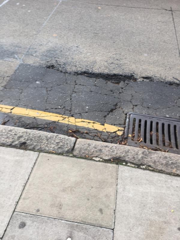 Pot hole 🕳 needs repairing! Wire is exposed -66 West Ham Lane, London, E15 4DS
