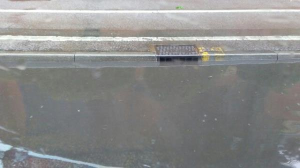 Blocked drain on corner of Aylestone Road at junction with Almond Road. This was well after the heaviest of the rain today and most surface water had drained away from other areas of the road, except here.-Ground Floor Shop, 283 Aylestone Road, Leicester, LE2 7QJ