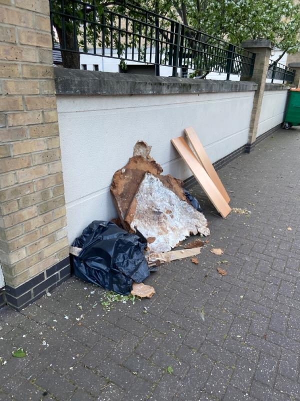 Piles of wood in street-Tudor House, 8 Wesley Avenue, Canning Town, E16 1TS