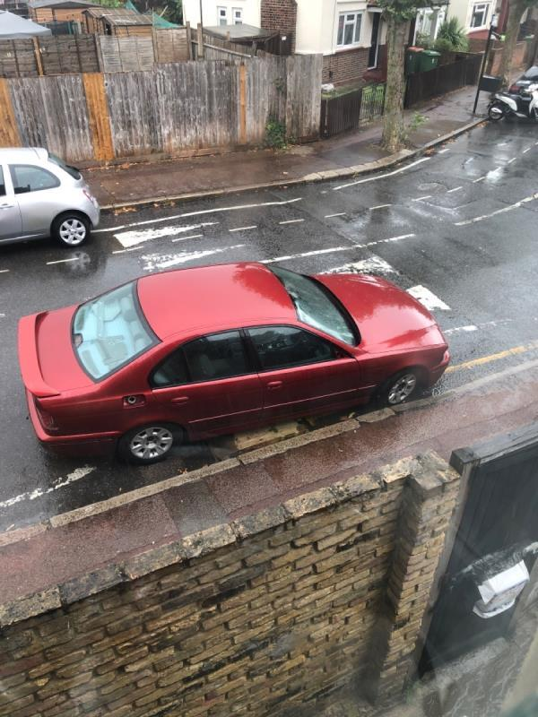 Abandoned vehicle. Has been at this spot for nearly 8 weeks. Car is completely stripped out, no steering wheel, no dash board etc  It's out outside my entrance 46a Vicarage Lane and is a healthy and safety hazard. It is leaking fuel/oil !  image 1-46a Vicarage Lane, London, E6 6DG