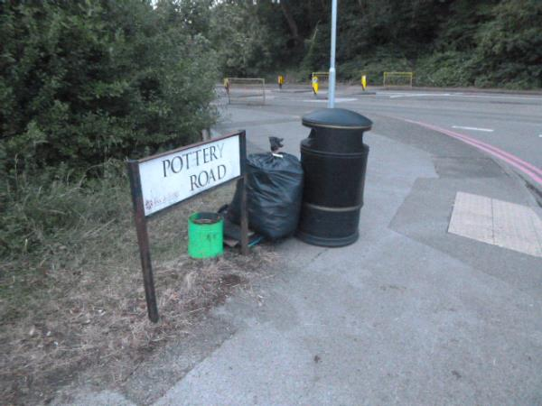 At the Pottery Road litter bin, ready for collection, is a sack of rubbish and other items collected from the abandoned campsite at the north west end of the park. -180 Norcot Rd, Tilehurst, Reading RG30 6BN, UK