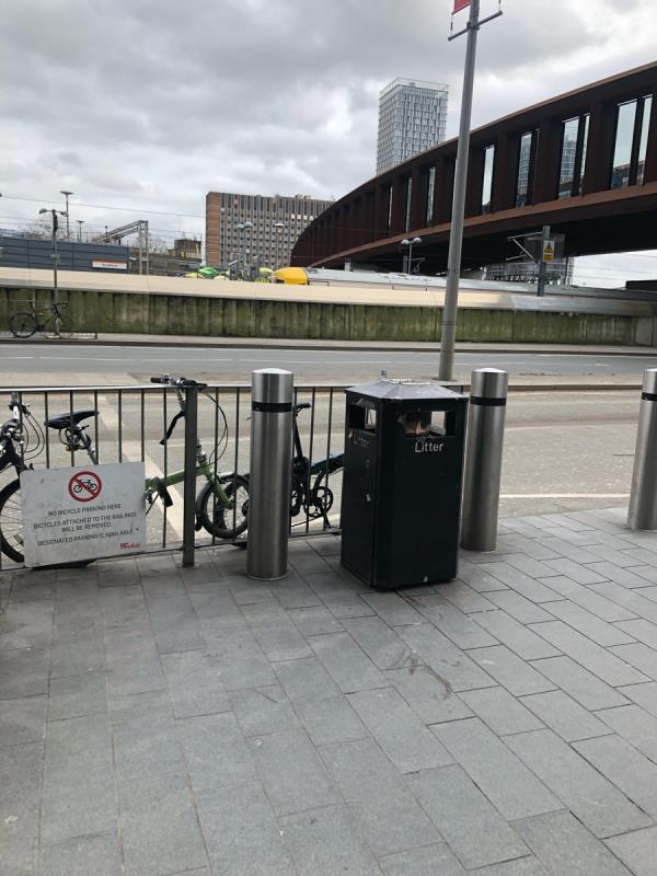 Bin full at pedestrian crossing outside one Stratford place.-Dhl Logistics Warehouse Montfichet Road, London, E20 1EH
