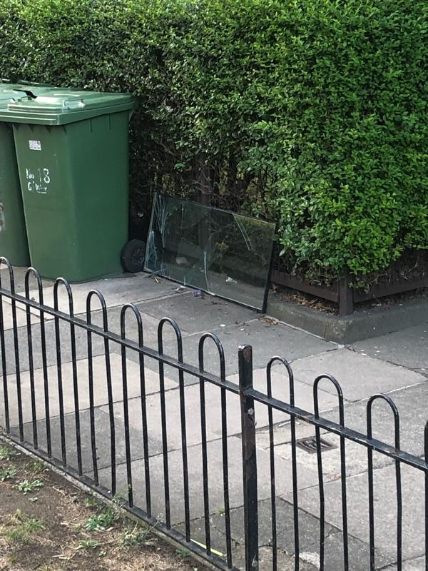 Broken glass fly tipping -100 Hammersley Road, London, E16 1FX