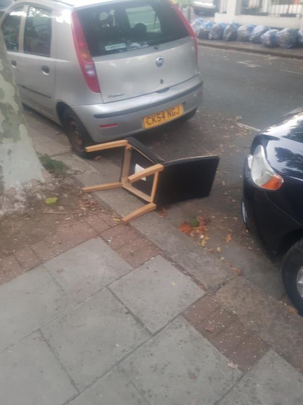 Chair fly tipped outside 62 Claude Road -62 Claude Road, London, E13 0QG